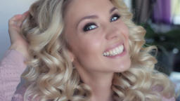 Beautiful sexy girl with curly hair smiling in a beauty salon Footage