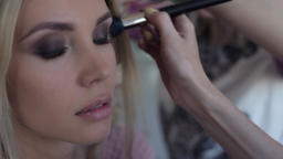 Close-up. Fashionable girl during make-up in a beauty salon Footage
