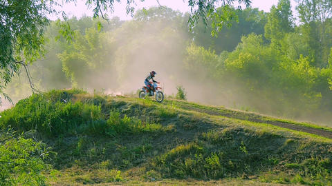 high speed rail amped through mud extreme sports motocross motorcycle jumping on Footage
