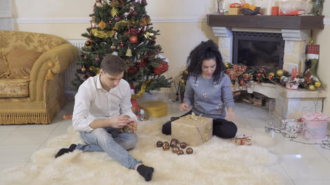 Lovely couple packs Christmas gifts Footage