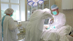 The surgical group of the hospital performs an operation using sterile surgical Footage