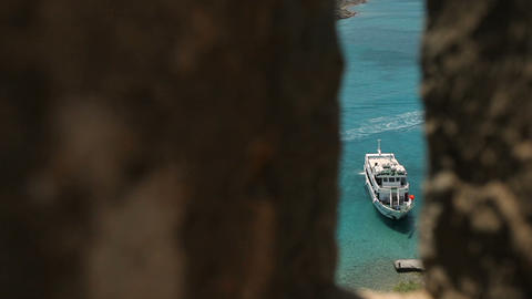 view of the sea through a window in the opposite wall. Crete Footage