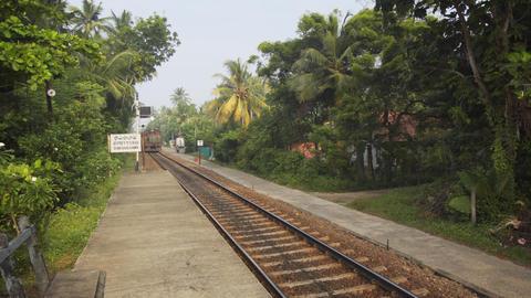 Deisel passenger train arriving at railway station at Thirana Gama. Sri Lanka Footage