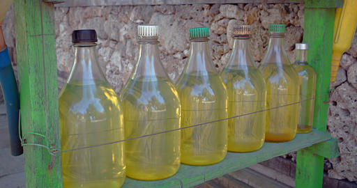 Gasoline. Sold from Glass Bottles in Rural Bali. Indonesia Footage