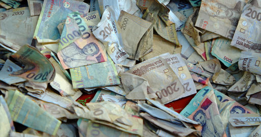 Heap of Indonesian Bank Notes as Religious Offerings in Temple Footage