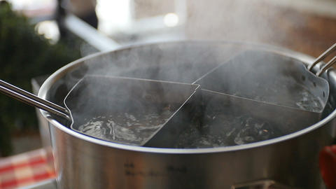 Boiling Water in a Pot Bubbling Over Footage
