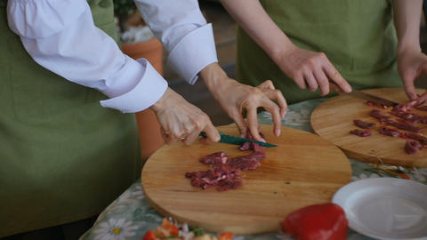 Multiple people slices Raw Meat On Wooden Board Image