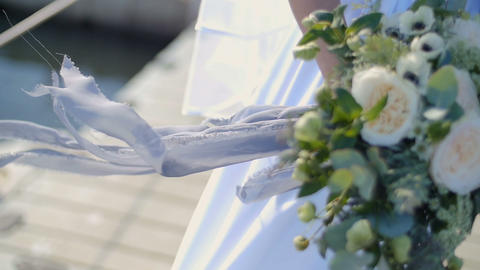 Bride in lace dress holding beautiful white and green wedding flowers bouquet Footage
