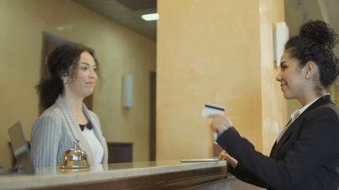 Businesswoman pays a credit card for a hotel room Footage
