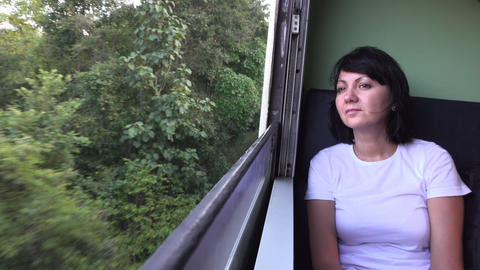 Smiling Woman Traveling On The Train Looking Out the open Window Footage