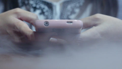 Texting and browsing smartphone for emergency contact, smoke spreading 실사 촬영