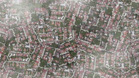 Aerial shot flying over city suburbs above clouds spy satellite drone 4k Footage