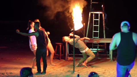 people doing the limbo under burning flame Footage