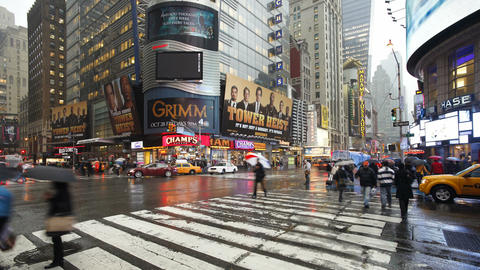 Busy intersection on a rainy evening on 42nd street at a... Stock Video Footage