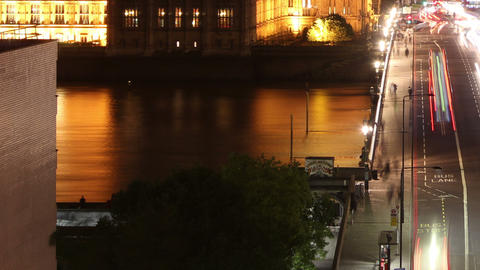 Big ben across westminster bridge at night tilt up right and zoom out Live Action