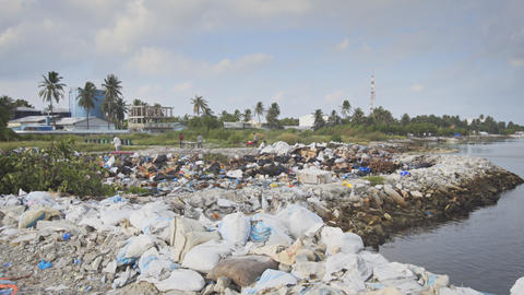 Workers Hauling Garbage at Local Landfill in the Maldives Footage