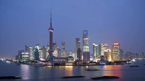 Shanghai night skyline view along huangpu river and the bund shanghai china Footage