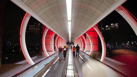 Illuminated walkway travelator time lapse of the entrance to a casino las vegas Footage