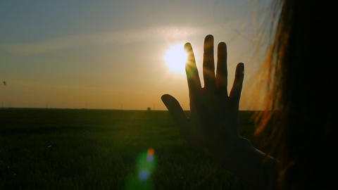 sun shining through the girl's hand Footage