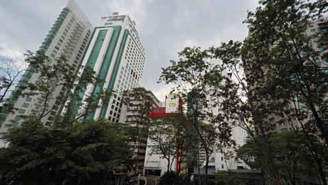 Unique Perspective shows trees and buildings in downtown Kuala Lumpur Live Action
