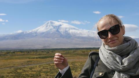 Portrait of vacation travel woman looking at Ararat mountain landscape. Nature Archivo
