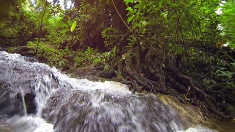 Camera Slowly Dips into Water beneath Exotic. Tropical Waterfall. with Sound Footage