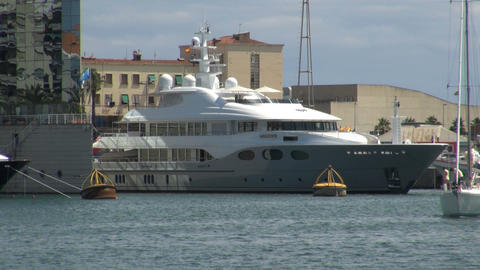 Closeup on large boat in barcelona harbor 영상물