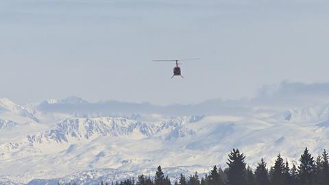 Chopper flying to snowy alaskan mountains 영상물