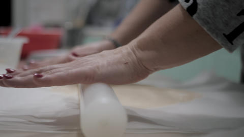 Woman rolling dough for pizza.Rolling dough for pizza Footage