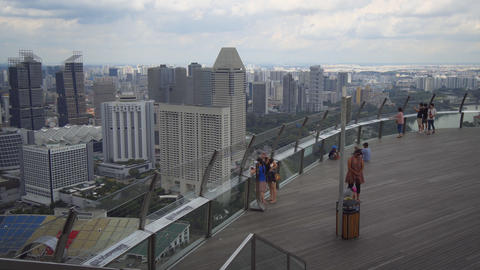 Tourists enjoying Marina Bay Sands observation deck Footage