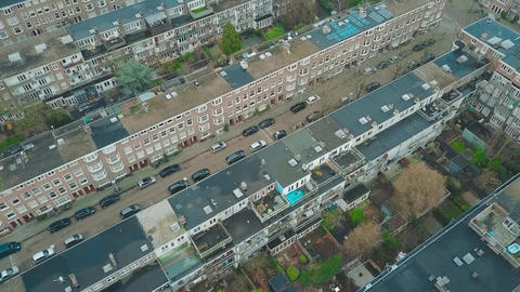 Aerial down view to apartment buildings and inner gardens and courtyards in Footage