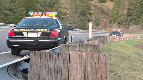 Highway patrol cars pulled over roadside Footage