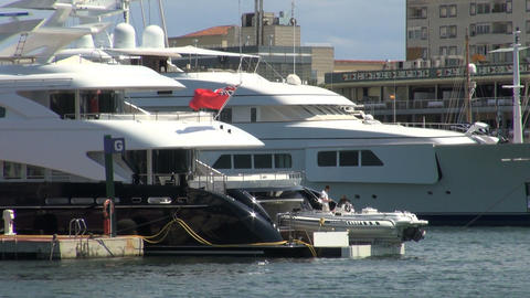 Pair of yachts in barcelona harbor Footage