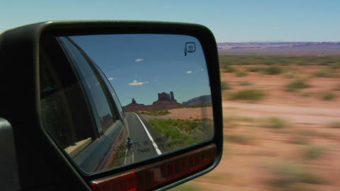 Monument valley highway in rearview mirror Footage
