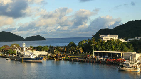 Tracking very wide shot of dock with boats in american samoa Live Action