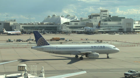 United plane taxiing to runway takeoff Live Action