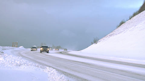 Winter road traffic on snowy highway in the mountains Footage