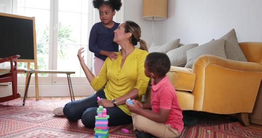 Mum with Kids building a tower Footage