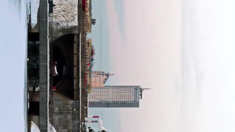 Vertical video. Dam with the Olympic clock, Yekaterinburg. Time Lapse Footage