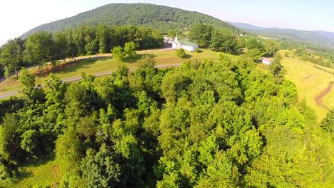 Aerial farm flyover summer Footage