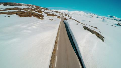 Mountain road in norway with high snow wall Live Action