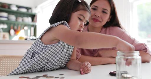 Girl saving her pocket money Footage