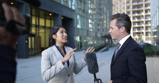 News presenter interviewing on the street Live Action