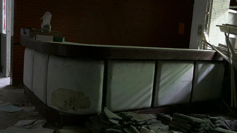 Walking to counter at abandoned hospital Footage