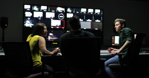 TV crew having meeting in control room Live Action