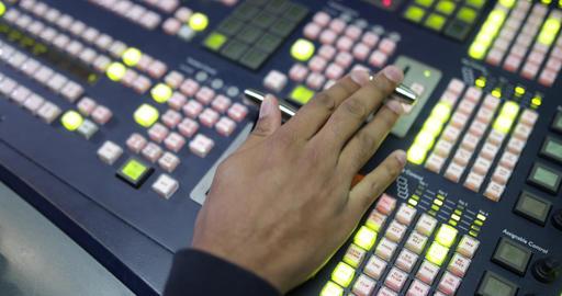 Close-up of hand operating TV control room technology ライブ動画