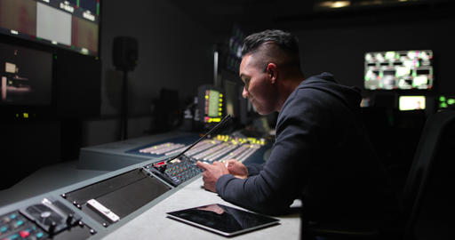 Operator in a control room at a television studio ライブ動画