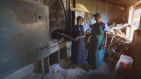 Local ladies explaining the use of antique equipment at a tea factory Footage