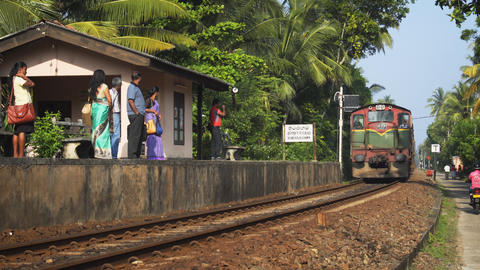 Diesel train arriving at Thiranagama Station in Hikkaduwa Live Action