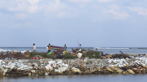 Workers moving garbage at landfill on Maafushi Island Footage